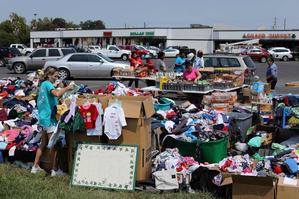 Daphanie Kingston (L) set up a relief center in a local shopping mall parking lot in the aftermath of tropical storm Harvey in Wharton, Texas, U.S., September 6, 2017. REUTERS/Mike Blake
