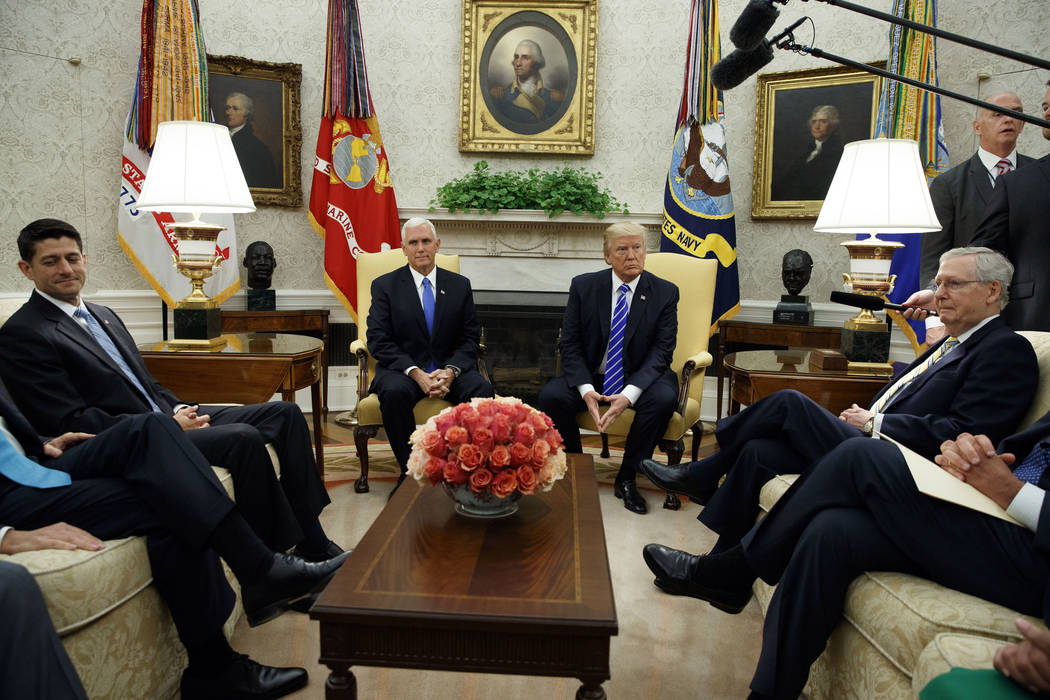 President Donald Trump pauses during a meeting with Congressional leaders in the Oval Office of the White House, Wednesday, Sept. 6, 2017, in Washington. From left, House Speaker Paul Ryan of Wis. ...