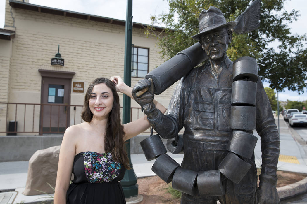 "Tsvetelina Stefanova, founder of Bad Moon Booking, which books shows for musicians, next to the Alabam statue, also known as the ""Toilet Paper Hero of Hoover Dam,"" in Boulder Cit ..."