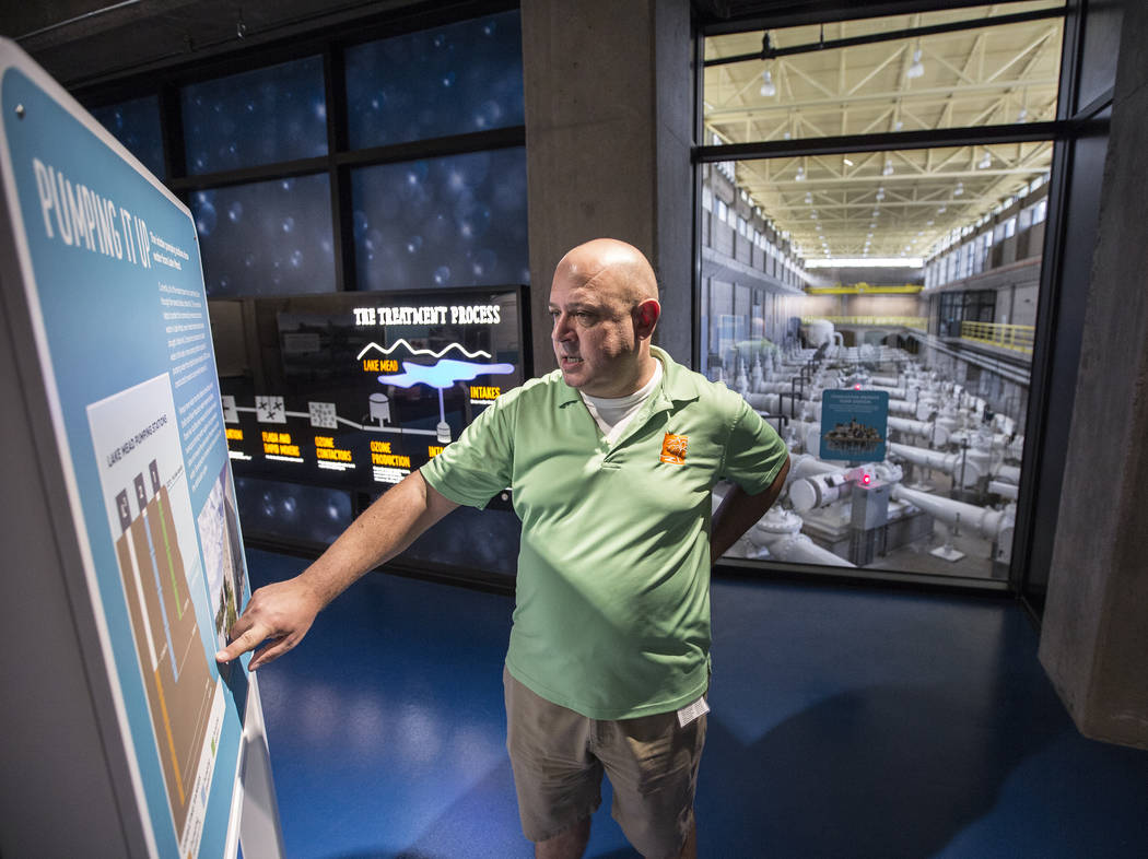 Curator Aaron Micallef discusses the system that allows large pumps to move water uphill from one local reservoir to another at the new Springs Preserve WaterWorks exhibit on Tuesday, September 5, ...