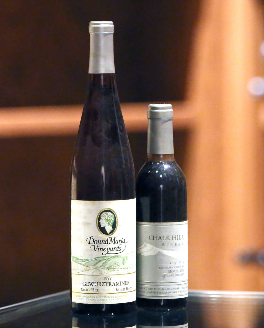 A 1982 Gewürztraminer bottle wine, left, and a 1984 Semillion wine are displayed at Chalk Hill Estate Vineyards' underground wine cellar, owned by the Vegas Golden Knights owner Bill Foley, i ...