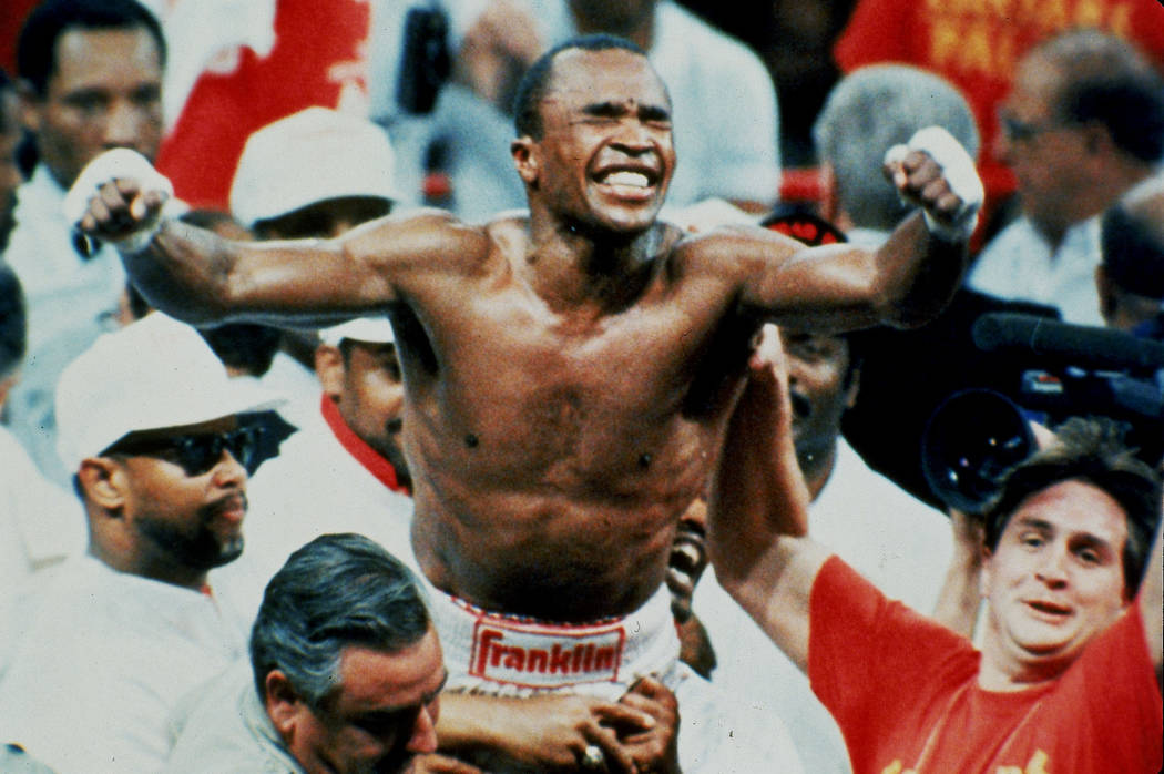 "Sugar Ray Leonard celebrates his middleweight boxing championship title after winning a 12-round split decision over middleweight champion ""Marvelous"" Marvin Hagler in Las Vegas, ..."