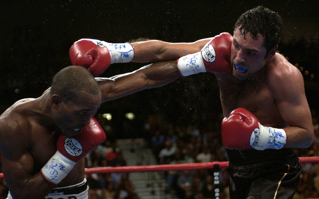 Bernard Hopkins, of Philadelphia, lands a left to the face of Oscar De La Hoya, of Los Angeles, in the seventh round during their unified middleweight title fight on Saturday, Sept. 18, 2004, at t ...