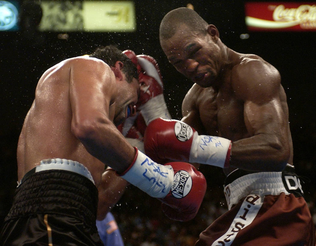 Bernard Hopkins, of Philadelphia, right, hits Oscar De La Hoya, of Los Angeles, in the eighth round during their unified middleweight title fight on Saturday, Sept. 18, 2004, at the MGM Grand Gard ...