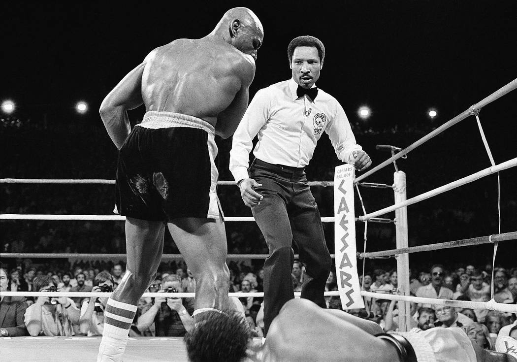 "Marvelous Marvin Hagler knocks Thomas ""Hitman"" Hearns to the mat in the third round of their undisputed world middleweight title fight in Las Vegas, April 15, 1985. (AP Photo)"