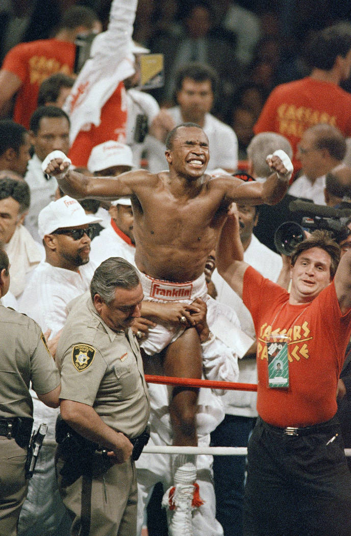 Sugar Ray Leonard celebrates winning the World Middleweight Boxing championship from Marvin Hagler in Las Vegas, April 6, 1987. Following the split decision win, Leonard retired from boxing. (AP P ...