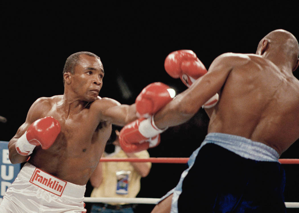 Sugar Ray Leonard, left, is shown during his bout with Marvin Hagler, April 6, 1987, in Las Vegas.  (AP Photo)
