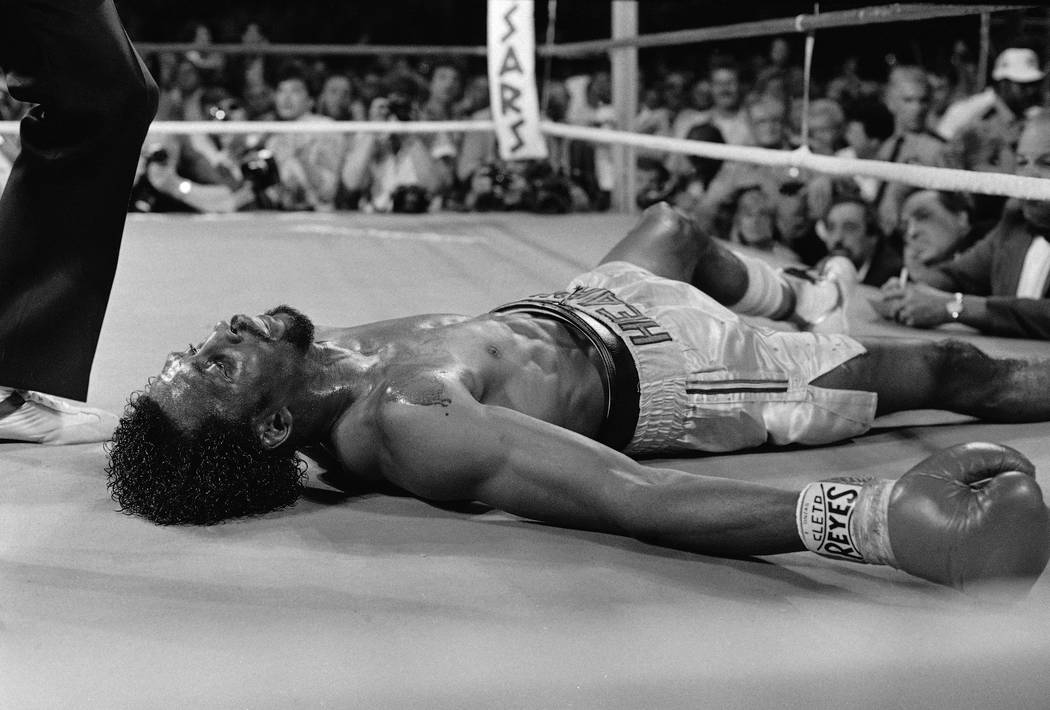 "Thomas ""Hitman"" Hearns lies on the mat after being knocked out by Marvelous Marvin Hagler in the third round of their undisputed world middleweight title fight Monday night, Apri ..."