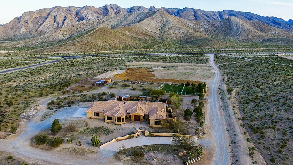 "This 2.120-acre horse property is at the base of Mount Charleston. Owner and custom homebuilder Royce ""Woody"" Woods has listed it for $1.5 million. (Windermere Prestige Properties)"