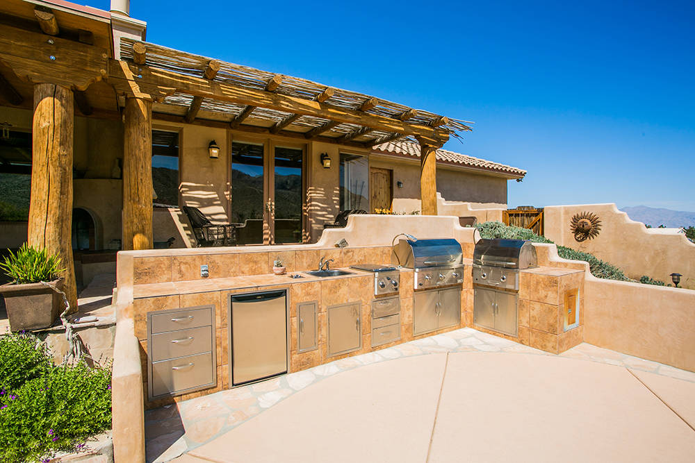 The backyard has an outdoor kitchen. (Windermere Prestige Properties)