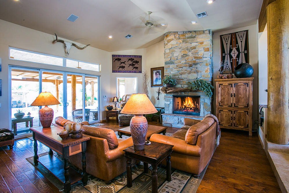 The living room has one of three fireplaces in the home. (Windermere Prestige Properties)
