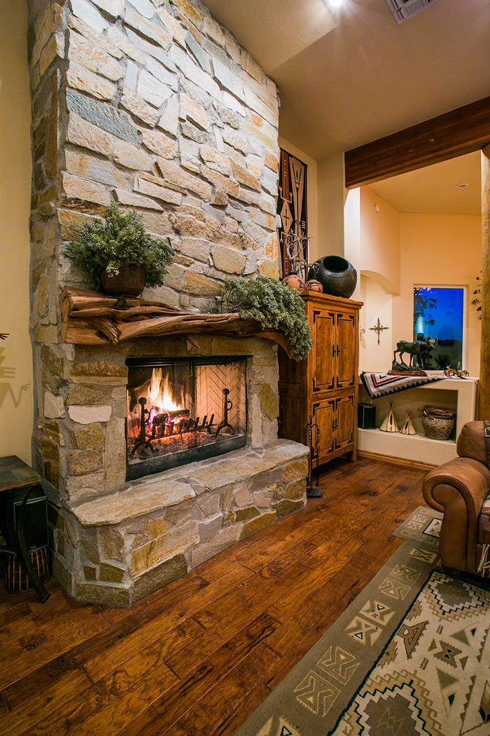 The home has three fireplaces. This one is in the living room. (Windermere Prestige Properties)