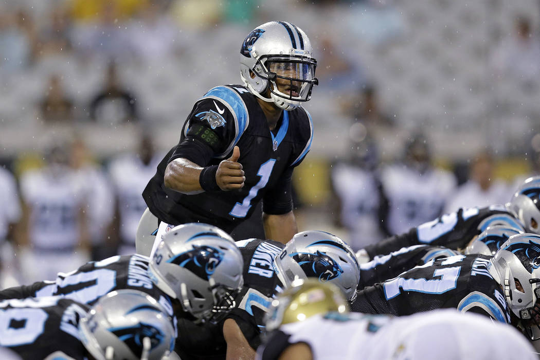 In this Aug. 24, 2017, file photo, Carolina Panthers quarterback Cam Newton call signals at the line of scrimmage during an NFL preseason football game against the Jacksonville Jaguars in Jacksonv ...