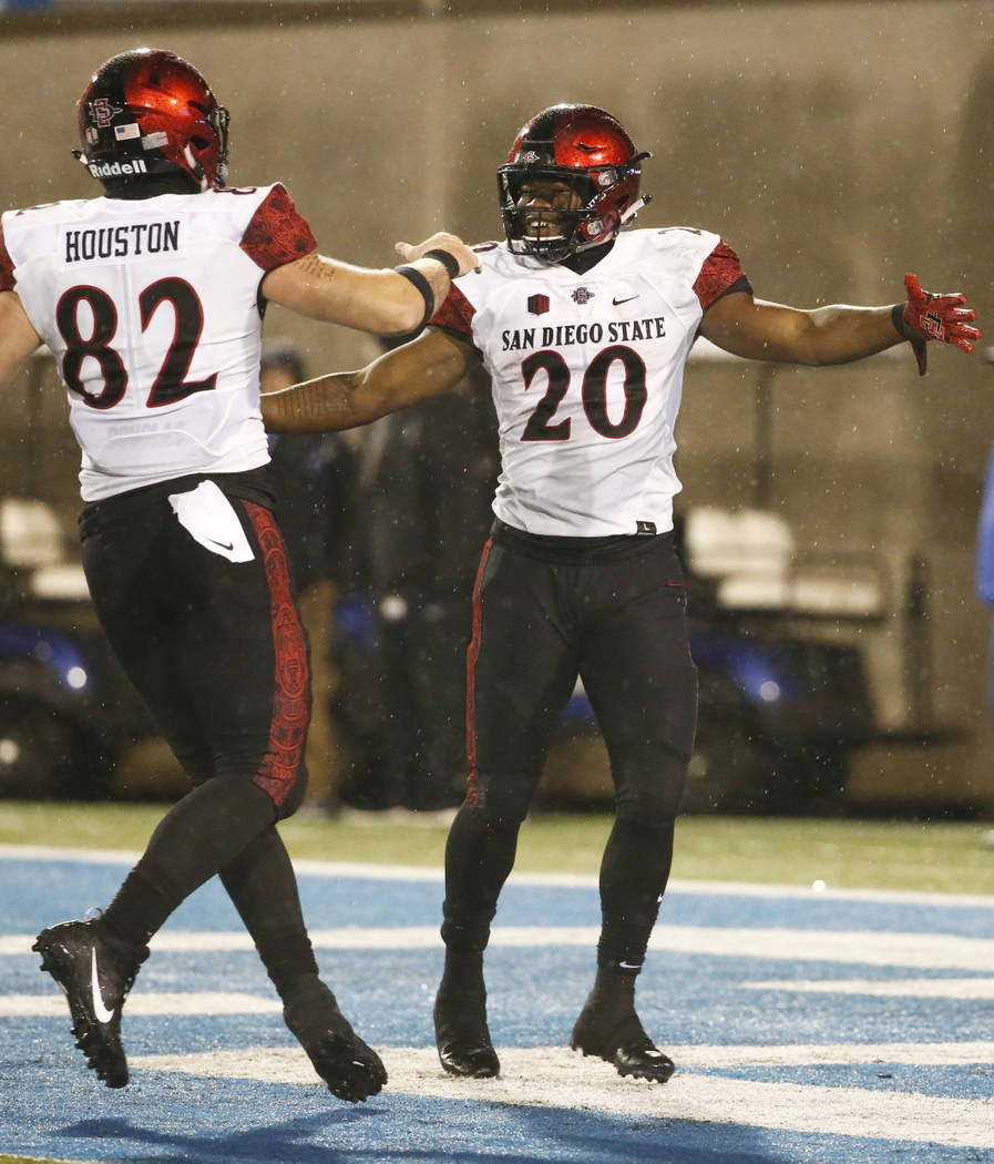 San Diego State running back Rashaad Penny (20) celebrates a touchdown against Air Force with Parker Houston (82) during an NCAA college football game, Saturday, Sept. 23, 2017, at Air Force Acade ...
