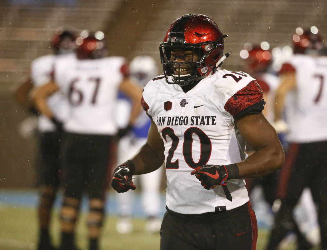 San Diego State running back Rashaad Penny (20) smiles as he heads back to the bench after scoring a touchdown against Air Force during an NCAA college football game, Saturday, Sept. 23, 2017, at  ...
