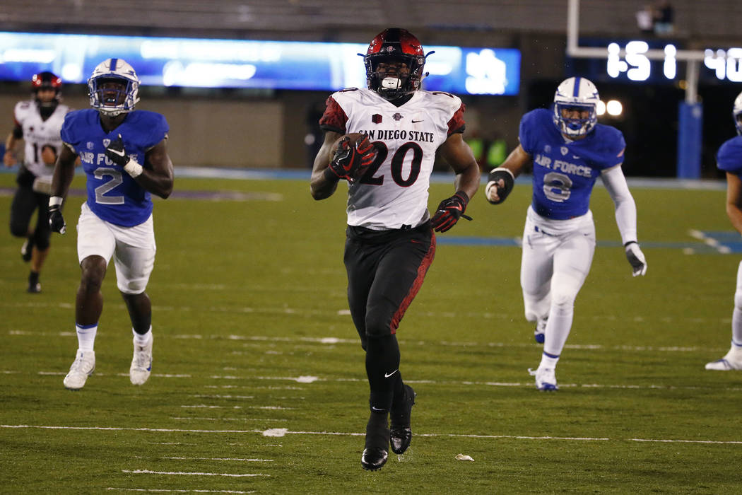 San Diego State running back Rashaad Penny (20) runs for a touchdown against Air Force during an NCAA college football game, Saturday, Sept. 23, 2017, at Air Force Academy, Colo. (AP Photo/Jack De ...