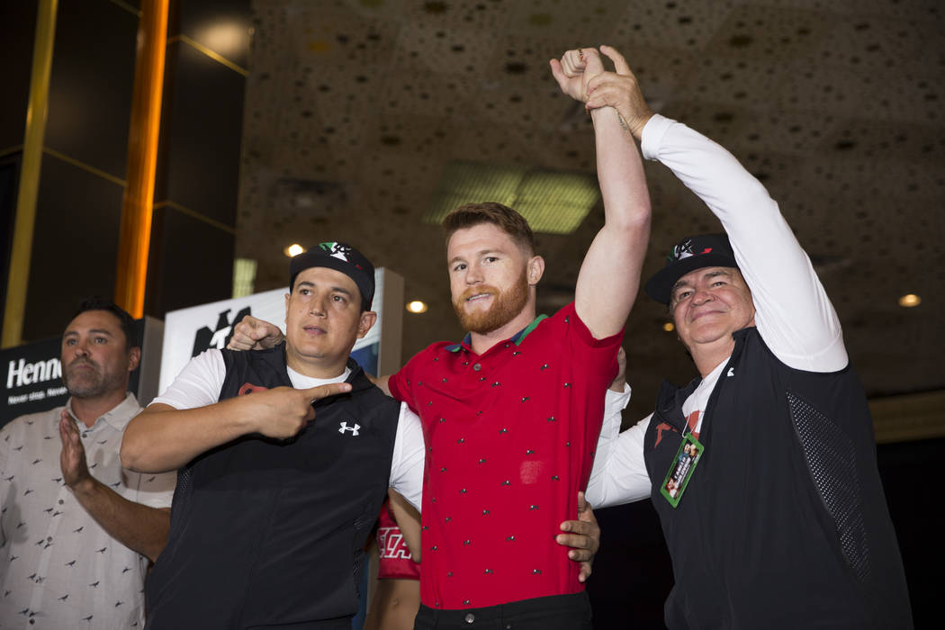 "Saul ""Canelo"" Alvarez, center, with his coaches Eddy Reynoso, left, and his father Jose ""Chepo"" Reynoso, during his ""grand arrival"" at the MGM ..."