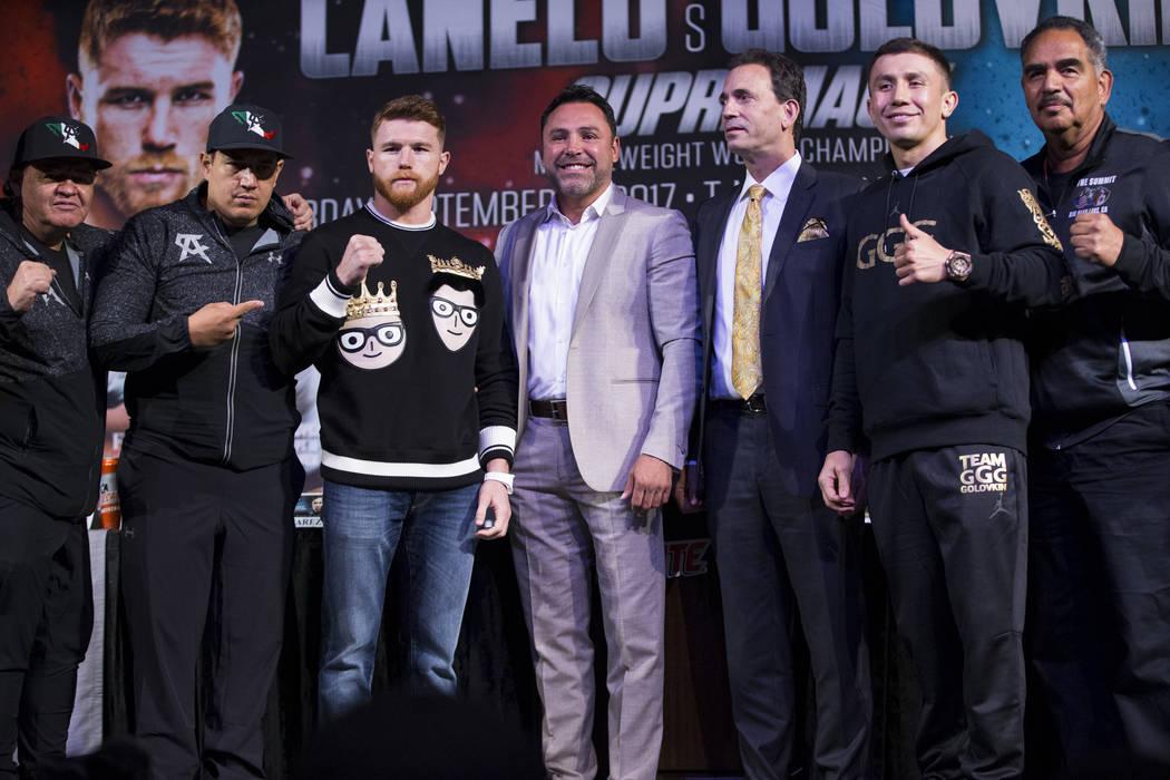 "Jose ""Chepo"" Reynoso, from left, his son Eddy, Saul ""Canelo"" Alvarez, Oscar De La Hoya, Tom Loeffler, Gennady Golovkin, and Abel Sanchez, during a press confere ..."