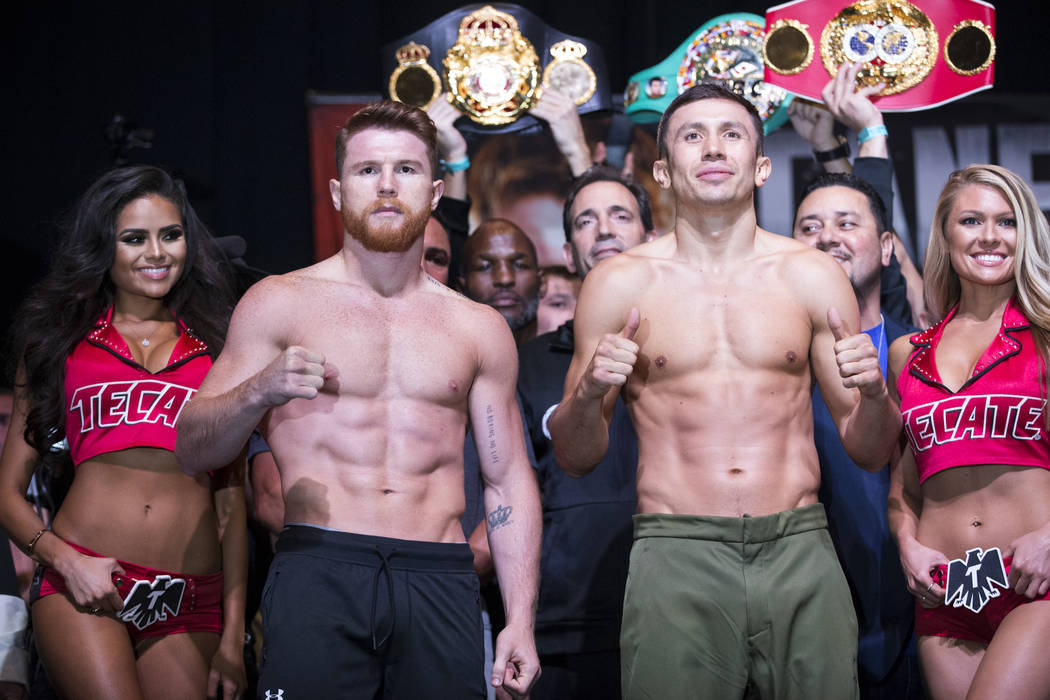 "Saul ""Canelo"" Alvarez, left, and Gennady ""GGG"" Golovkin during a weigh-in event at MGM Grand Garden Arena in Las Vegas, Friday, Sept. 15, 2017. Alvarez and Golo ..."