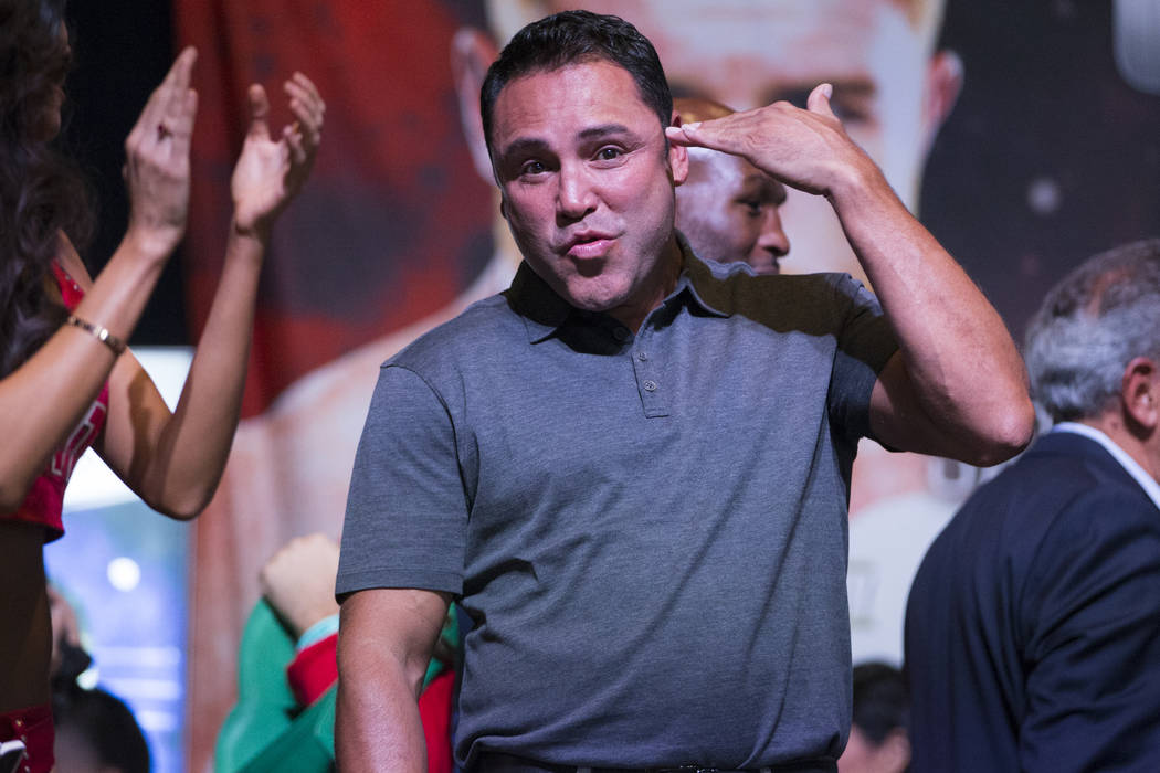 Boxing promoter Oscar De La Hoya reacts after a scuffle between Randy Caballero and Diego De La Hoya during a weigh-in event at MGM Grand Garden Arena in Las Vegas, Friday, Sept. 15, 2017. Caballe ...