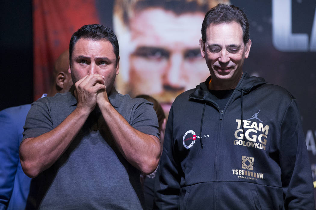 Boxing promoters Oscar De La Hoya, left, and Tom Loeffler during the weigh-in event for Saul Canelo Alvarez and Gennady GGG Golovkin at the MGM Grand Garden Arena in Las Vegas, Friday, Sept. 15, 2 ...