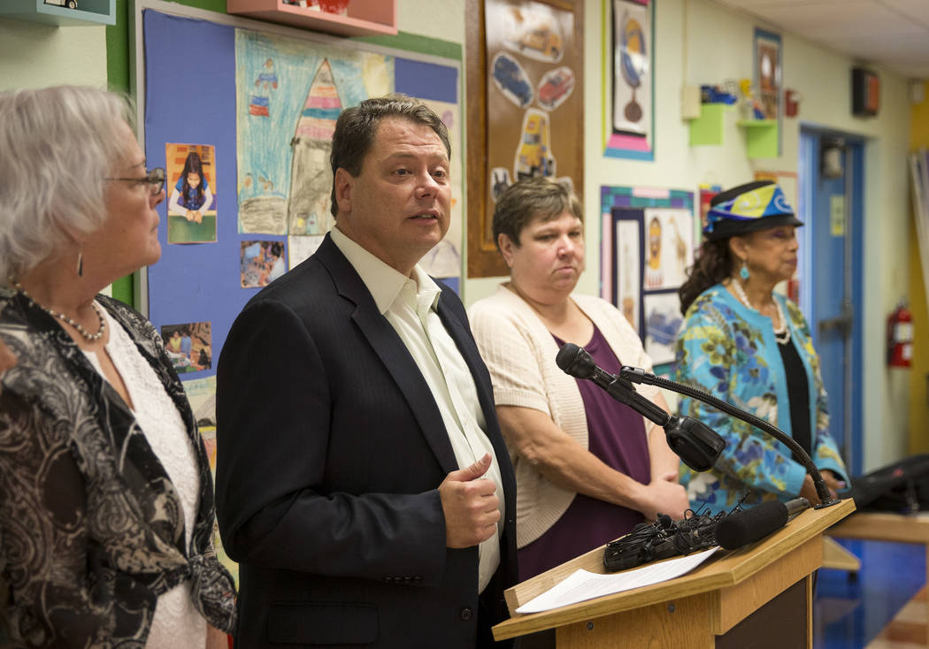 Clark County School District Superintendent Pat Skorkowsky, second left, announces he will be retiring after his contract ends during a press conference held at Walter Bracken Academy on Thursday, ...