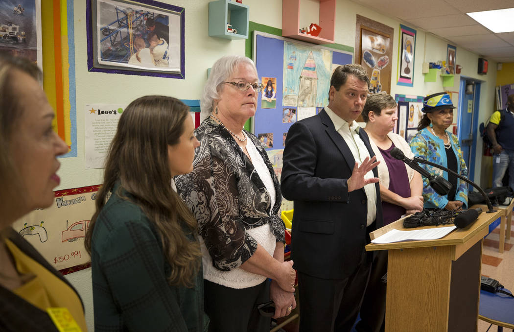 Clark County School District Superintendent Pat Skorkowsky, third from right, announces he will be retiring after his contract ends during a press conference held at Walter Bracken Academy on Thur ...