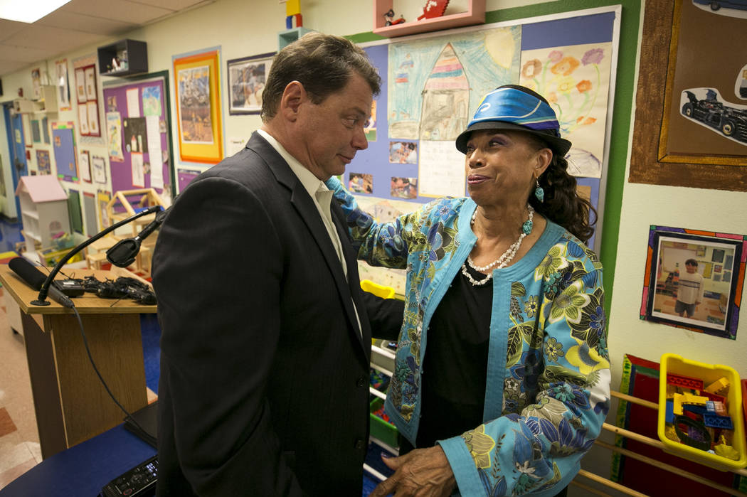 Clark County School District Superintendent Pat Skorkowsky, left, talks with CCSD Board of Trustees president Linda Young after announcing his retirement during a press conference held at Walter B ...