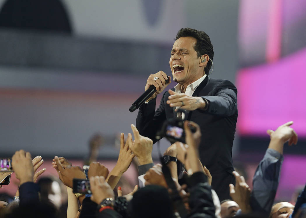 FILE - In this April 24, 2014, file photo, Singer Marc Anthony performs during the Latin Billboard Awards in Coral Gables, Fla. In a gala on the eve of the Latin Grammys in Las Vegas, on Wednesday ...