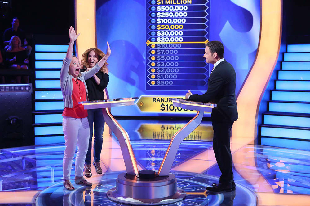 """Contestant Ranjani Brow plays the game with """"Jill Smith and host Chris Harrison. (Ronda Churchill, Disney/ABC Home Entertainment and TV Distribution)"""