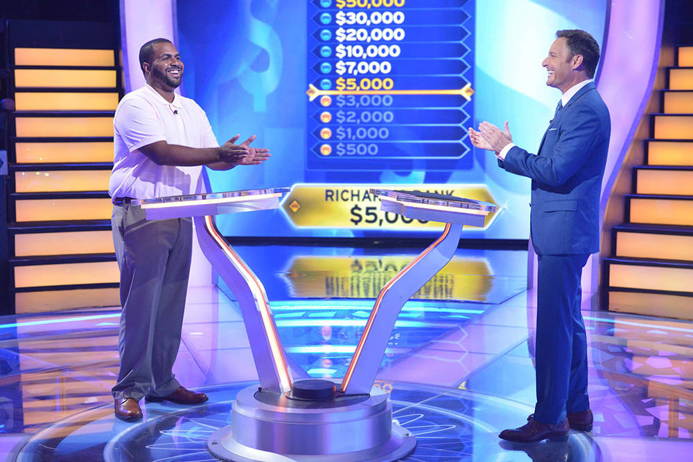 """Contestant Richard Banks with host Chris Harrison on """"Who Wants To Be A Millionaire."""" (Jacob Kepler Disney/ABC Home Entertainment and TV Distribution)"""