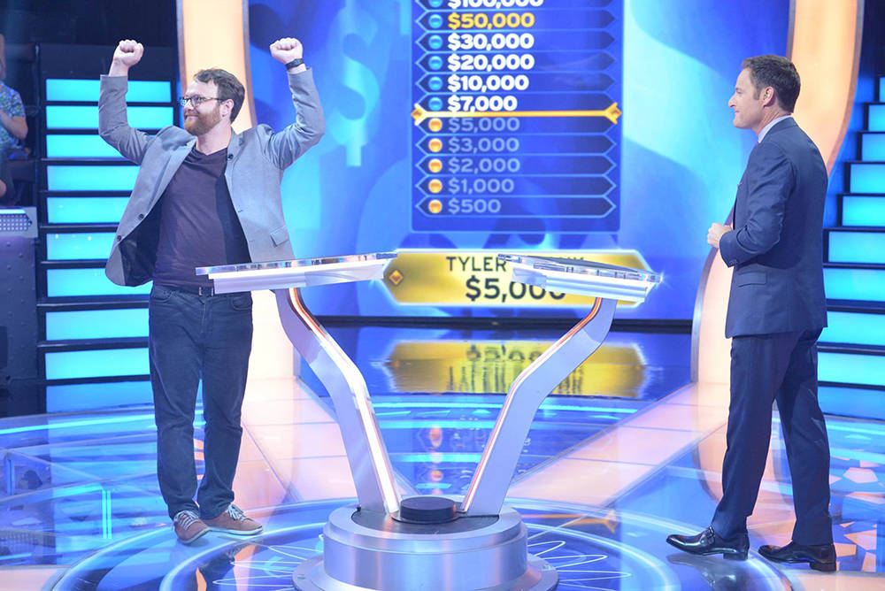 """""""Who Wants To Be A Millionaire"""" contestant Tyler Crosby celebrates as he answers the $5,000 question, on the episode airing Tuesday, Sept. 12. (Jacob Kepler - Disney/ABC Home Entertainment and TV  ..."""