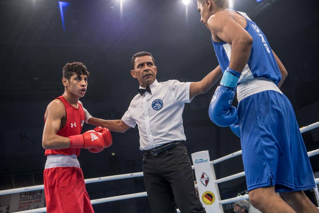 Freudis Rojas (left), a Las Vegas native, won the bronze medal at the AIBA World Boxing Championships last week in Germany. (Courtesy Karim de la Plaine/AIBA)