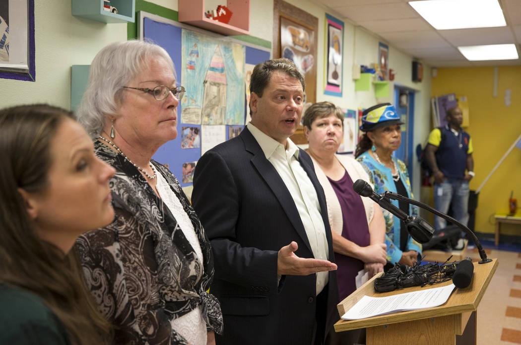 Clark County School District Superintendent Pat Skorkowsky, third from left, announces he will be retiring after his contract ends during a press conference held at Walter Bracken Academy on Thurs ...