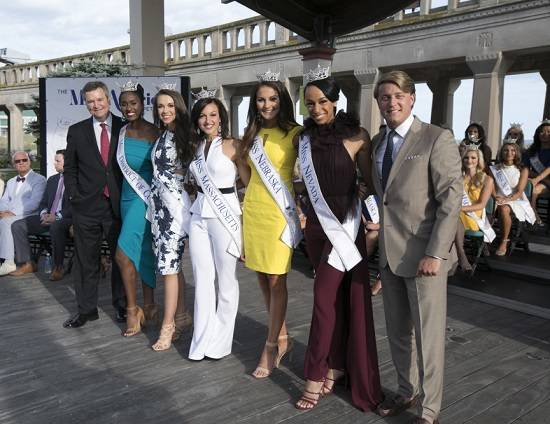 Miss America pageant Executive Chairman Sam Haskell, left, and Josh Randle, president Miss America Organization, left, pose with Miss Nevada, Andrea Martinez, second to right, and other contestant ...
