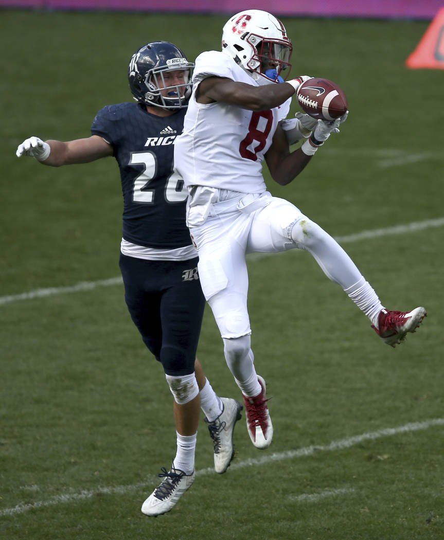 Stanford's wide receiver Donald Stewart, right, catches a pass in front of Rice's safety Cole Thomas during their U.S. college football game in Sydney, Sunday, Aug. 27, 2017. (AP Photo/Rick Rycroft)