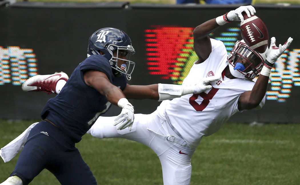 Stanford's wide receiver Donald Stewart, right, is unable to bring down the catch over Rice's cornerback Justin Bickham during their U.S. college football game in Sydney, Sunday, Aug. 27, 2017. (A ...