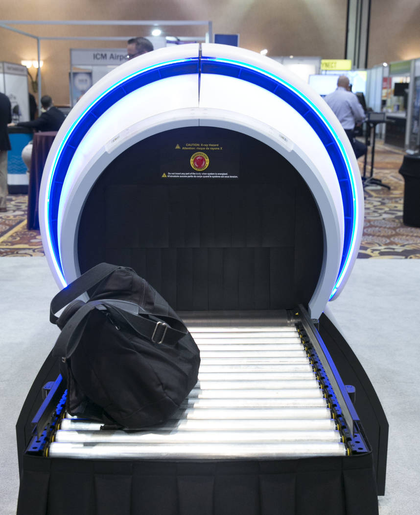 Analogic's ConneCT Aviation Checkpoint Screening System is displayed during the Future Travel Experience expo at the Mandalay Bay on Friday, Sept. 8, 2017, in Las Vegas. Analogicճ ConneCT sy ...