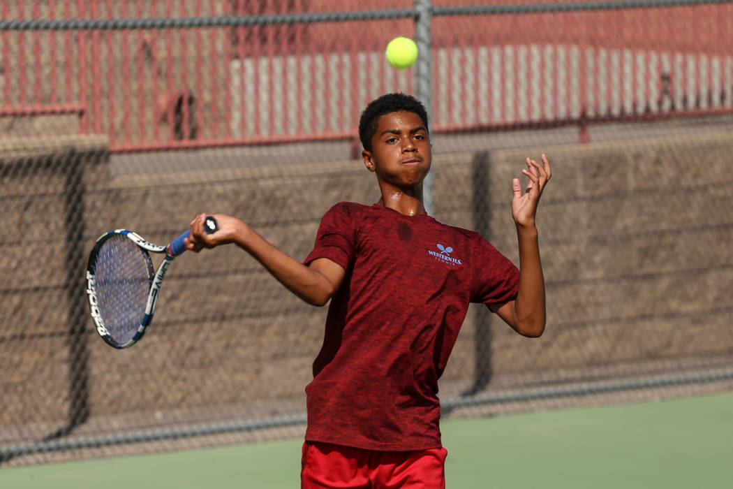 Rua Elmore of Western High plays against Sunrise Mountain's boys tennis team at Western High School in Las Vegas, Monday, Sept. 11, 2017. Joel Angel Juarez Las Vegas Review-Journal @jajuarezphoto