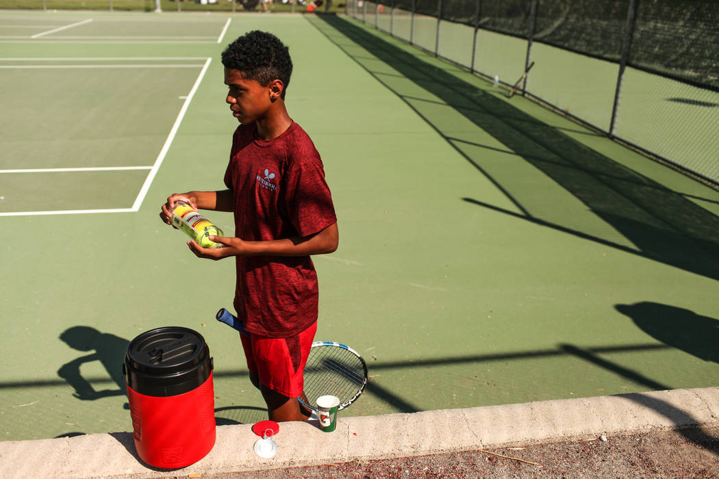 Rua Elmore of Western High opens a set of new tennis balls before a match against Sunrise Mountain at Western High School in Las Vegas, Monday, Sept. 11, 2017. Joel Angel Juarez Las Vegas Review-J ...