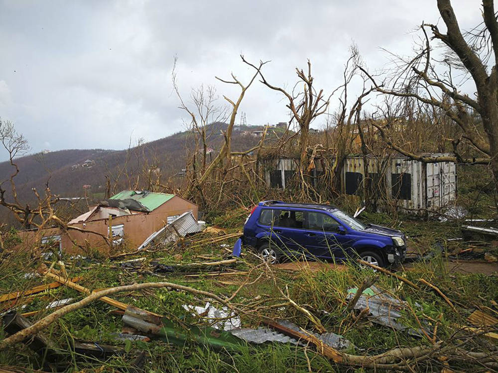 This Thursday, Sept. 7, 2017 photo shows storm damage in the aftermath of Hurricane Irma in Tortola, in the British Virgin Islands. Irma scraped Cuba's northern coast Friday on a course toward Flo ...
