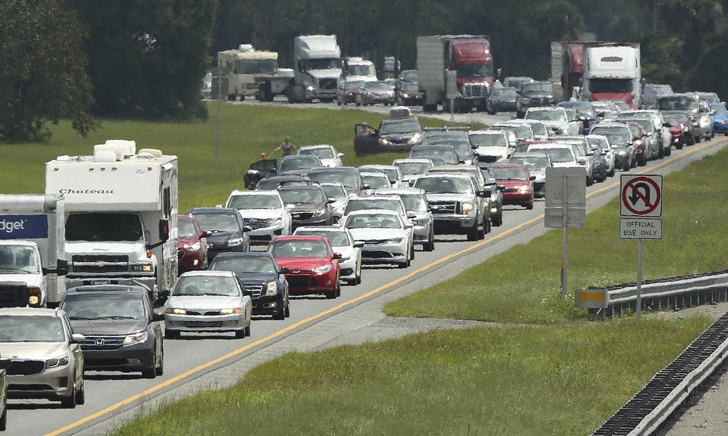 Traffic rolls at a crawl on the northbound lanes of Florida's Turnpike near the intersection of I-75 in Wildwood, Fla. on Friday, Sept. 8, 2017. Motorists are evacuating for the anticipated arriva ...