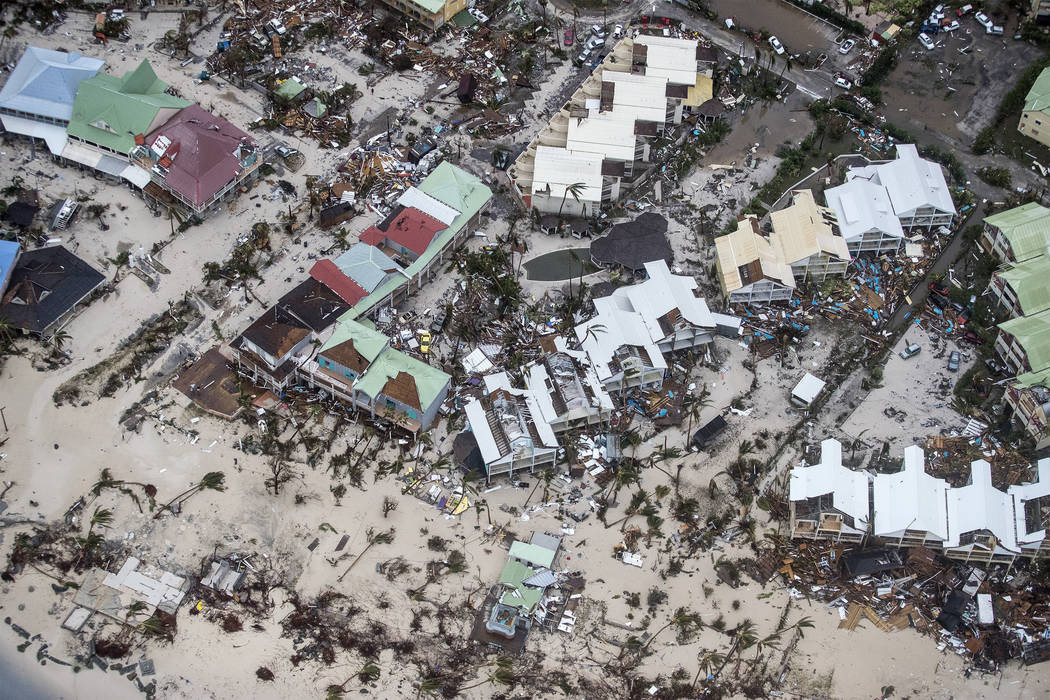 This Sept. 6, 2017 photo provided by the Dutch Defense Ministry shows storm damage in the aftermath of Hurricane Irma, in St. Maarten. Irma cut a path of devastation across the northern Caribbean, ...