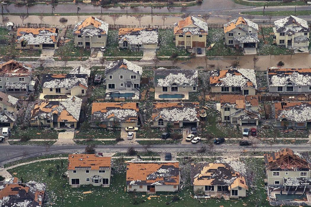 FILE - In this Aug. 25, 1992, file photo, rows of damaged houses sit between Homestead and Florida City, Fla., after Hurricane Andrew struck.  After a catastrophic Hurricane Andrew revealed how la ...