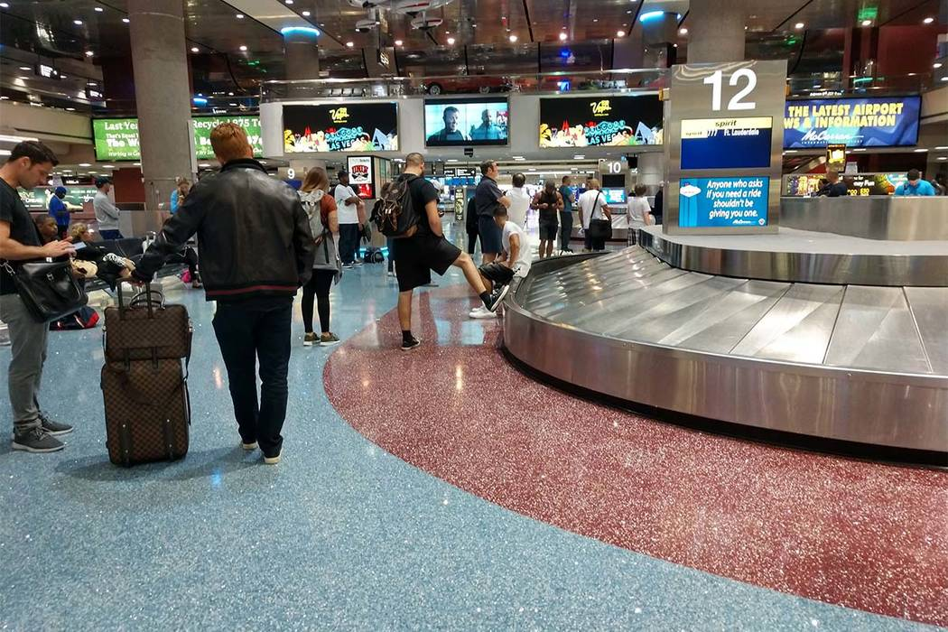 Passengers arrive early Friday morning at McCarran International Airport. (Max Michor/Las Vegas Review-Journal)