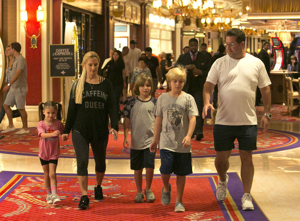 Tammy Dorfman, second left, her husband David Feldbaum, her children Aaliyah Dorfman, 4, left, Ariel Feldbaum, 9, and his twin brother Aaron walk inside Wynn hotel-casino on Saturday, Sept. 9, 201 ...