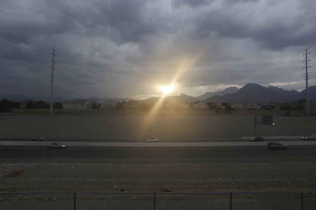 The sun peeks through clouds over the 215 freeway near   Palo Verde High School in Las Vegas, Friday, Sept. 8, 2017. Gabriella Angotti-Jones Las Vegas Review-Journal @gabriellaangojo