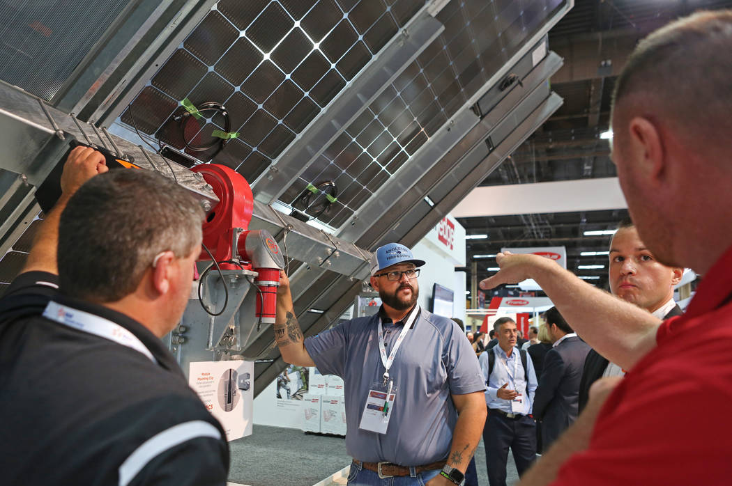 Richard Mitchell with Blattner Energy look at a Sf7 Tracker by Soltec during the Solar Power International 2017 at the Mandalay Bay Convention Center in Las Vegas, Monday, Sept. 11, 2017. (Elizabe ...