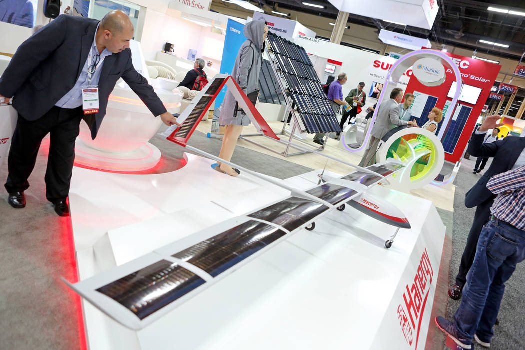 A model plane with thin filmed solar panels made by Hanergy, a Chinese owned company that is the top producer of thin filmed solar panels, is displayed during the Solar Power International 2017 at ...