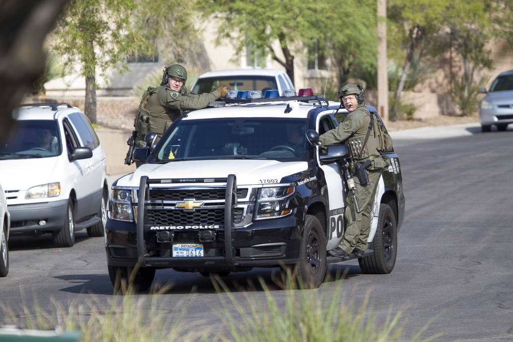 Las Vegas police work a barricade situation near Far Hills Avenue and Sageberry Drive in the Summerlin area of Las Vegas on Friday, Sept. 8, 2017. (Richard Brian/Las Vegas Review-Journal) @vegasph ...